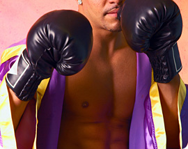 Boxer in robe and boxing gloves