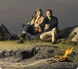 Couple relaxing by a campfire