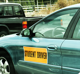 Car with student driver sign