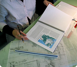 Landscape architect working with plans and maps