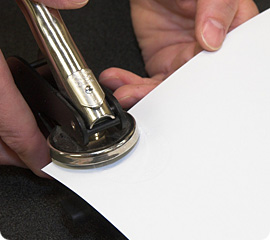 Document being embossed with a notary seal
